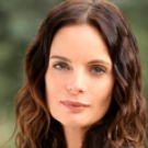 Gabrielle Anwar as Caroline Waverly