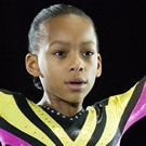 Sydney Mikayla as Gabby Douglas (age 7-12)